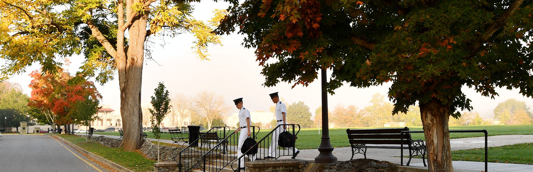 Photo of cadets walking on post with autumnal foliage
