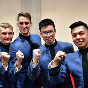 Cadets at Class Supper, posing with fists up