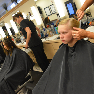 Cadets receiving first haircuts