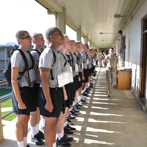 Cadets lined up along barracks hallway