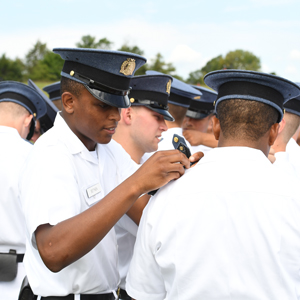 Cadets pinning on badges at New Market