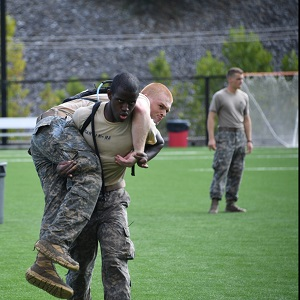 Cadet carrying another at the Rat Crucible