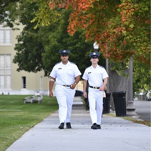Cadets in white walking on Post on an autumn day