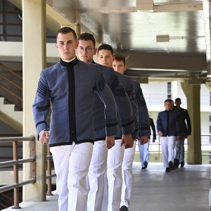 Cadets marching along barracks hallway