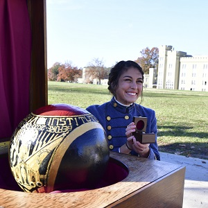 Female cadet posing with new class ring