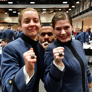 Cadets posing with new rings at the Class Supper