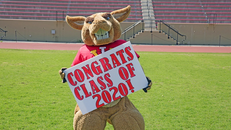Moe holding a Congratulations sign. Photo from VMI Athletics