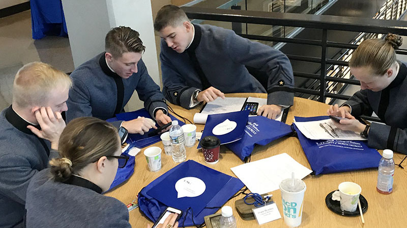 Cadets Reagan Goulla '18, Tiernan Keast '20, Carter Johnson '20, Rush Earman '18, and Madeline Barrett '20 discuss ethical dilemmas during the 2017 Mid-Atlantic Regional Intercollegiate Ethics Bowl.—Photo courtesy of Col. Emily Miller.