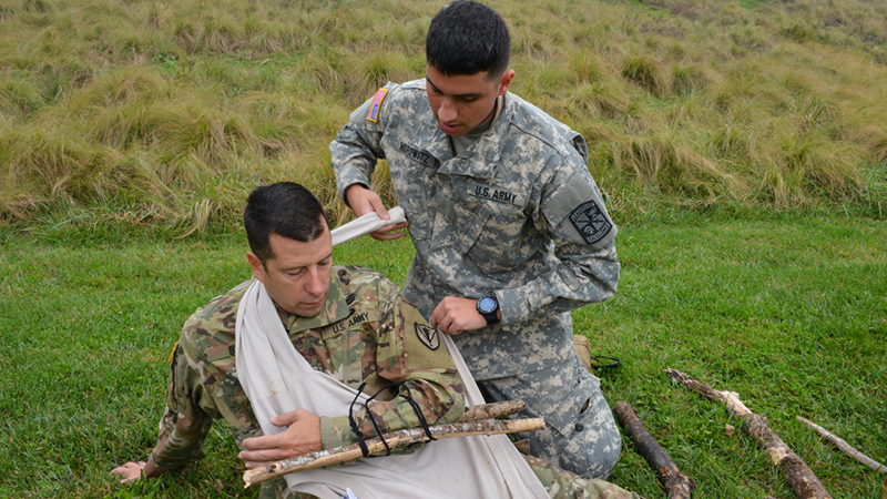 Cadet practicing medical treatment in the field.