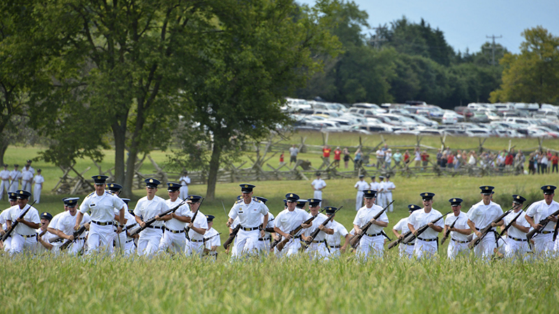 Cadets charging across field on Oath Day.