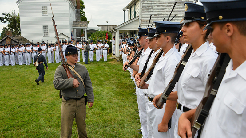 Cadets lined up with interpreter for Oath Day.