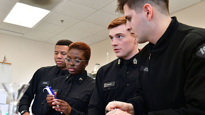 Cadets (from left) Tavis Andrews '20, Holly Njabo '20, John Hatgas '19, and Corey Johnstone '19 ready their DNA samples for analysis.