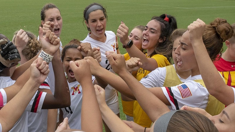 Women's soccer team in a huddle. Photo from VMI Athletics