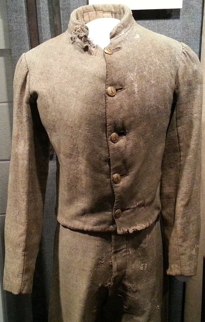 Photo of Cadet Smith's uniform depicting bullet damage.